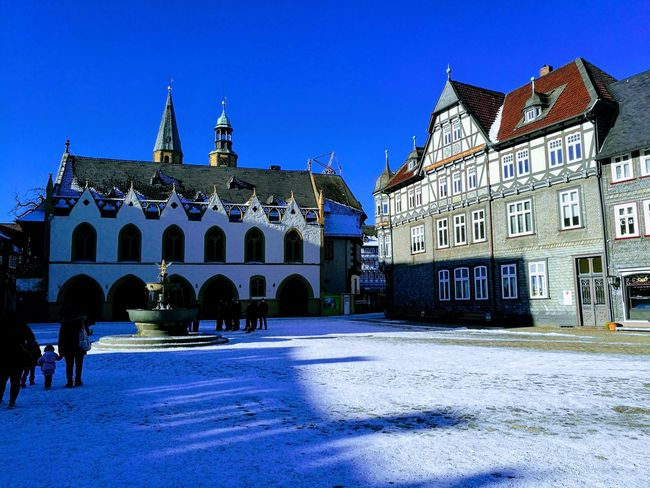 Goslar, Winter Goslar Snow Covered Shadows & Lights Blue Architecture Old Town Snow Covered Place Of Interest Town Square People In The Background Town Hall EyeEmNewHere