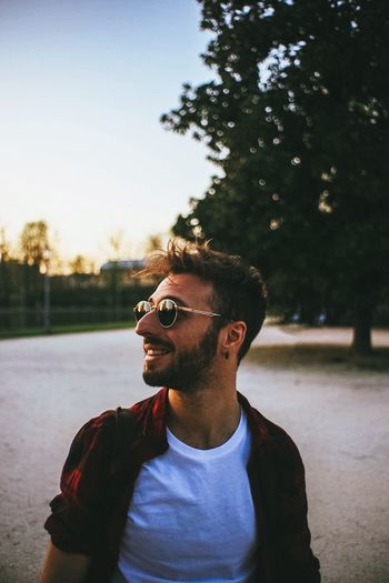 Cinematic Vintage Glasses Sunglasses Young Men One Person Lifestyles Tree Real People Young Adult Fashion Sky Plant Casual Clothing Leisure Activity Front View Nature Standing Focus On Foreground Portrait Headshot Outdoors