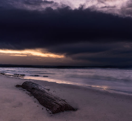 and then the storm came and carried all my worries away No People Low Tide Wave Sea Sunset Beach Water Sand Sun Red Sky Seascape Dramatic Sky Storm Cloud Atmospheric Mood Storm Cloudscape Overcast Moody Sky Thunderstorm Coast Surf Tide