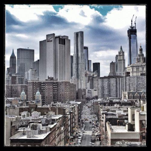 Modern cityscape against cloudy sky