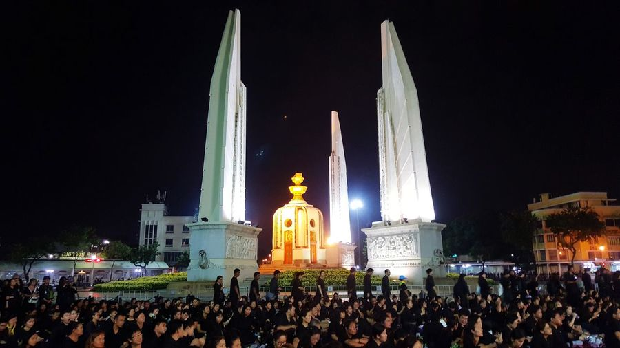 Victory monument Bangkok Thailand Victory Monument Large Group Of People Religion Night Arts Culture And Entertainment Illuminated Architecture Crowd Spirituality People Travel Destinations Outdoors Sky Adult Adults Only
