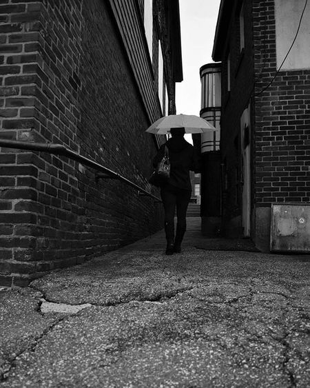 R a i n y D a y . . . . . . . Streetphotography Streetphoto Mobilephotography Mobilephoto Citylife Citystreets Brickbuilding Diner Alleys Alleyway Bnw_life Blackandwhite Monochrome Blackandwhitephotography Concretejungle RainyDay Newhampshire Newengland Candid InMotion Dailylife Shotonnikon Monoart Mono Walkingalone women artwork photography photographyislife