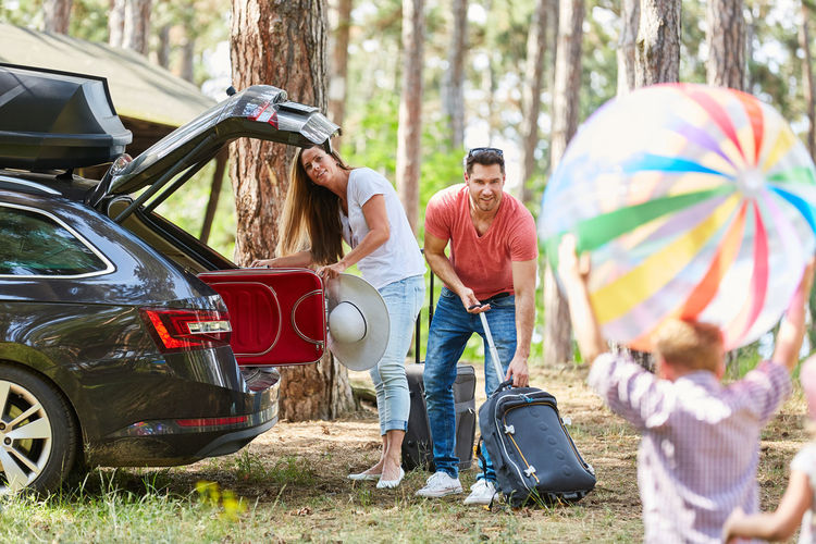Family with car at park