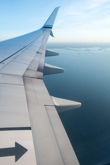 Aerial View Air Vehicle Aircraft Wing Airplane Airplane Wing Beauty In Nature Close-up Day Flying Journey Mid-air Mode Of Transport Nature No People Outdoors Scenics Sea Sky Tranquility Transportation Travel Water