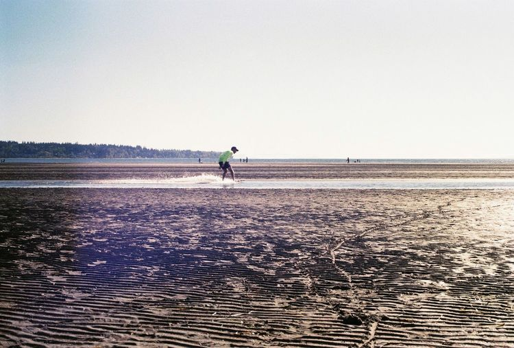 Skimboarding Flat Land 35mm Film Photography WHITE ROCK BC British Columbia, Canada Sea One Person Sunny Beach Full Length Clear Sky Outdoors Adult Water Vacations Low Tide