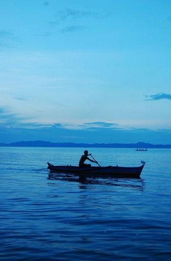 Coastal Blue Color Palette Color Pallete Blue Sky Blue Skies Blue Sea Calm Water Quezon Province Summer Boat Silhouette Fisherman Outline Sea EyeEm Phillippines Tranquility