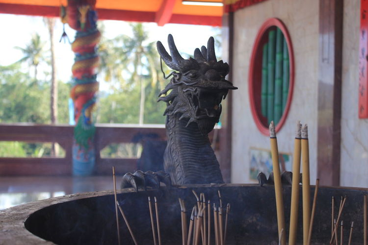Dragon Animal Animal Representation Animal Themes Animal Wildlife Art And Craft China Dragon Close-up Day Domestic Domestic Animals Focus On Foreground Indoors  Looking Mammal Mouth Open No People One Animal Representation Sculpture Statue Vertebrate Window