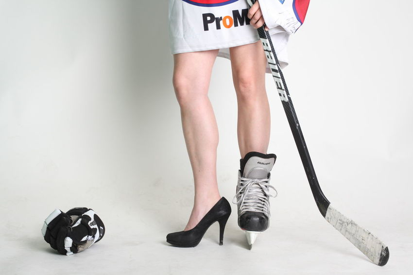 Hockey Girl shows shoes Hockey Fans Ice NHL Puck Shoe Adult Adults Only Day Fan Girl Girly Golf Golf Club Golfer Hockey Hockey Game Hockey Game! Hockey Shoe Hockey Sticks Human Body Part Human Leg Indoors  Low Section One Person One Woman Only People Shoes ıce