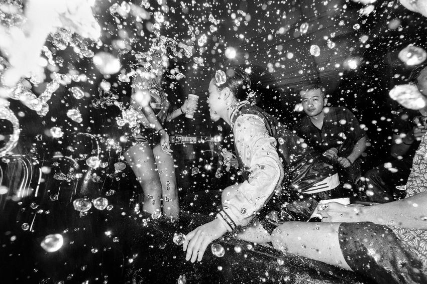 Freak Songkran / Songkran is an annual festival in Thailand celebrating the traditional Thai New Year. Water is splashed and poured onto people as a symbol of washing away all of their sins and bad luck. Sometimes, it gets a little freaky. Bangkok Thailand Street Photography Streetphotographer Photooftheday Streetphoto Streetphotography Streetphoto_bw Black & White Black And White EyeEm Best Shots Showcase July Dark Blackandwhite Car Water Check This Out Bangkok Thailand.