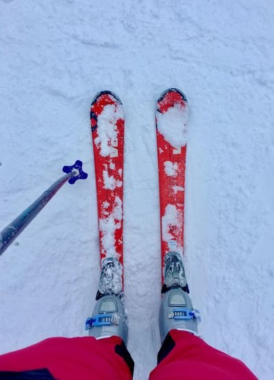 Skiing Body Part Cold Temperature Day Directly Above Finger Frozen High Angle View Human Body Part Human Foot Human Leg Human Limb Low Section One Person Personal Perspective Real People Red Shoe Snow Unrecognizable Person White Color Winter Winter Sport