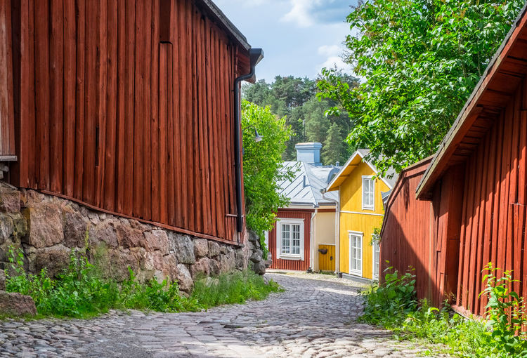 Beautiful city landscape with idyllic street view and old buildings at summer day in Porvoo, Finland Architecture Built Structure Building Exterior Building House Residential District Plant Footpath Direction No People The Way Forward Outdoors Sunlight City Tree Nature Alley Street Cloud - Sky Day Summer Travel Destinations Porvoo Finland Stone Rock - Object Wood - Material Idyllic Old Vintage Bright Tree Lush Foliage Town Village