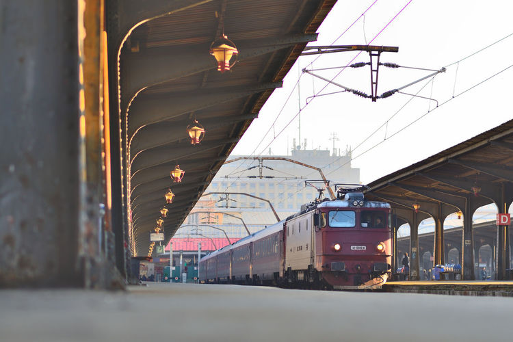 """Getting ready to hit the """"road"""" Bucharest Evening Light Journey Low Angle View Perspective Power Line  Railroad Station Railroad Station Platform Railroad Track Train Transportation Travel"""
