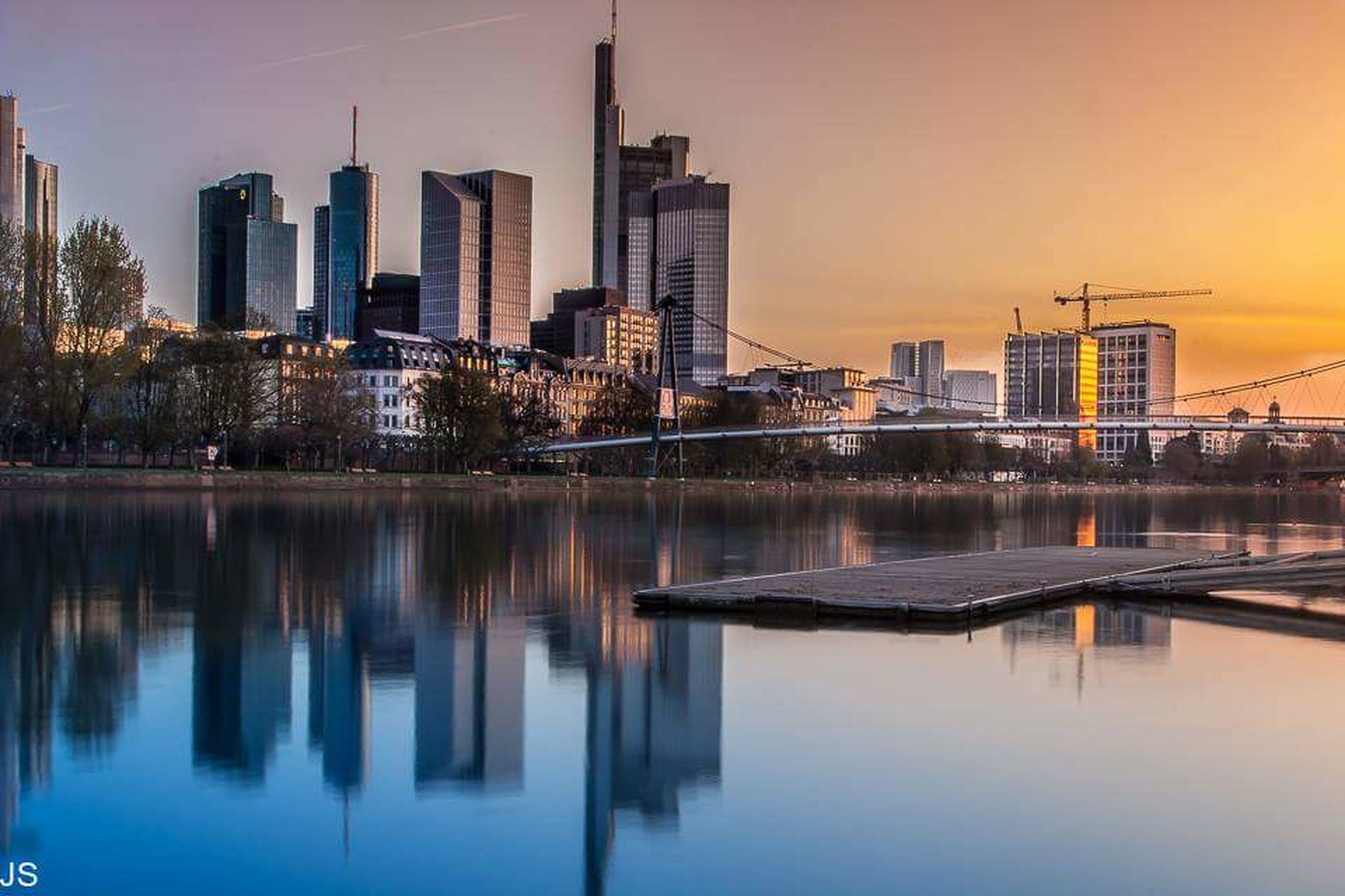architecture, building exterior, built structure, reflection, city, water, skyscraper, waterfront, sunset, modern, office building, river, tall - high, cityscape, tower, urban skyline, sky, building, lake, skyline