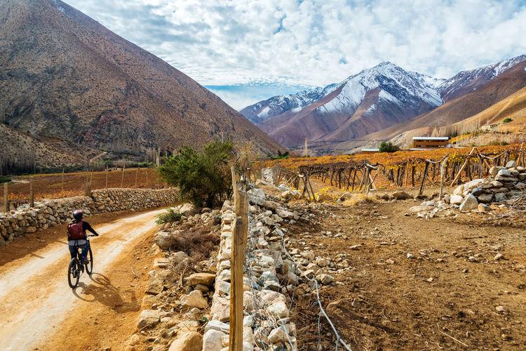 Woman mountain biking through elqui valley