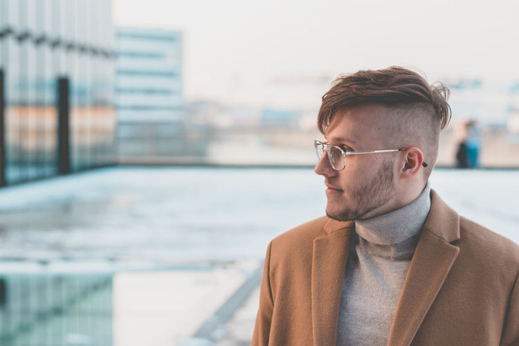 Architecture Building Exterior Built Structure City Contemplation Day Eyeglasses  Fashion Focus On Foreground Front View Glasses Headshot Looking Men One Person Outdoors Portrait Real People Young Adult Young Men