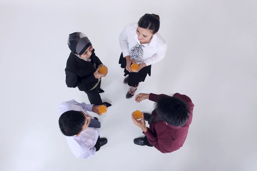 high angle view of group of people in business wear discussion Business Discussion Indian Teamwork Business Person Chinese Friendship Full Length Glass Of Orange Juice Group Of People Harmony High Angle View Hijab Holding Malay Malaysian Mixed Race Multiracial  Portrait Studio Shot Talking Togetherness Tudung United Young Adult
