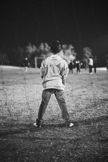 Rear view of boy defending soccer goal