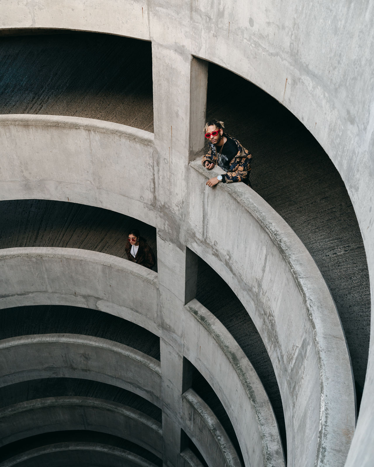 HIGH ANGLE VIEW OF PEOPLE ON VEHICLE
