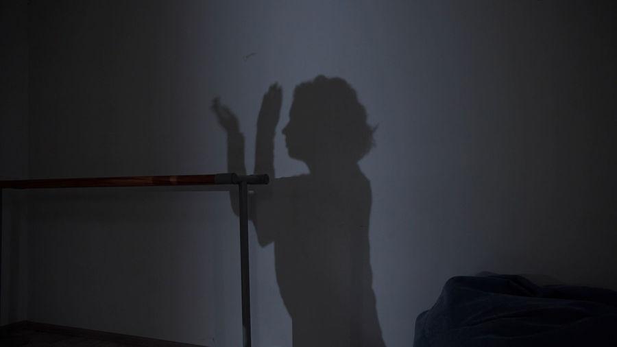 Shadow of woman on wall in darkroom
