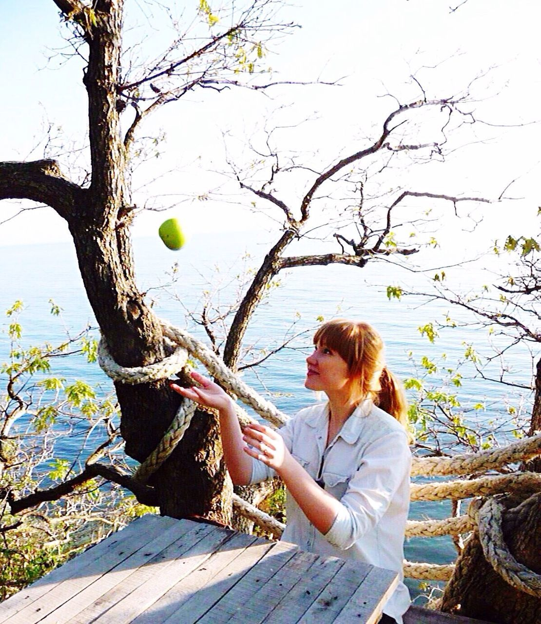 one person, young adult, young women, redhead, ball, day, concentration, women, outdoors, real people, skill, tree, one young woman only, balloon, one woman only, only women, sky, adult, people, adults only