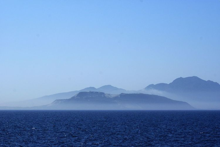 Islands in the fog Kos, Greece Beauty In Nature Blue Clear Sky Copy Space Day Idyllic Islands In The Fog Mountain Mountain Range Nature No People Non-urban Scene Nyssiros Outdoors Scenics - Nature Sea Sky Tranquil Scene Tranquility Water Waterfront