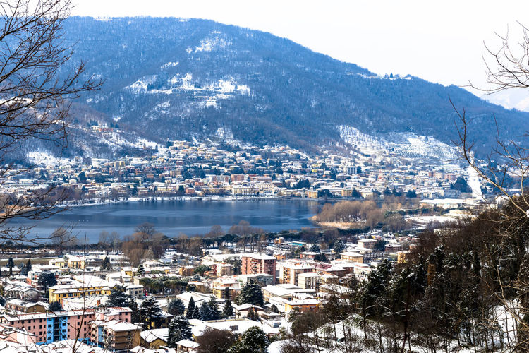 Calolziocorte 2018 MR7 Architecture Beauty In Nature Building Exterior Built Structure Canon City Cityscape Cold Temperature Day Eos77D House Mountain Mountain Range Nature No People Outdoors Scenics Sky Snow Town Tranquility Tree Water Winter