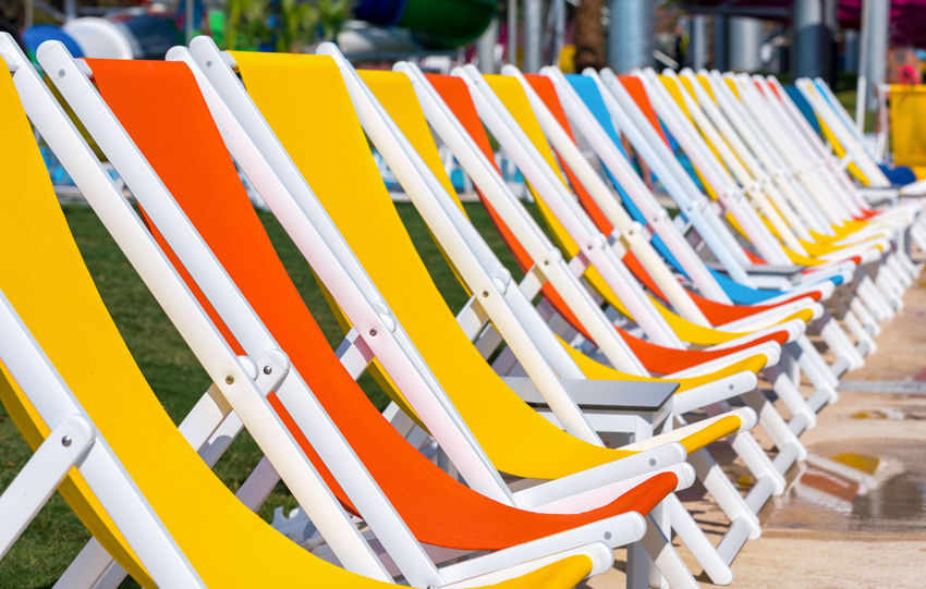 Colored sunchairs in a row Chair Holiday Red Blue Chair Close-up Color Day Empty In A Row Large Group Of Objects Multi Colored No People Outdoors Row Seat Summer Sun Sunchair Vacation Yellow