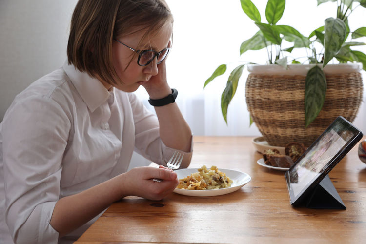 Midsection of woman holding food on table