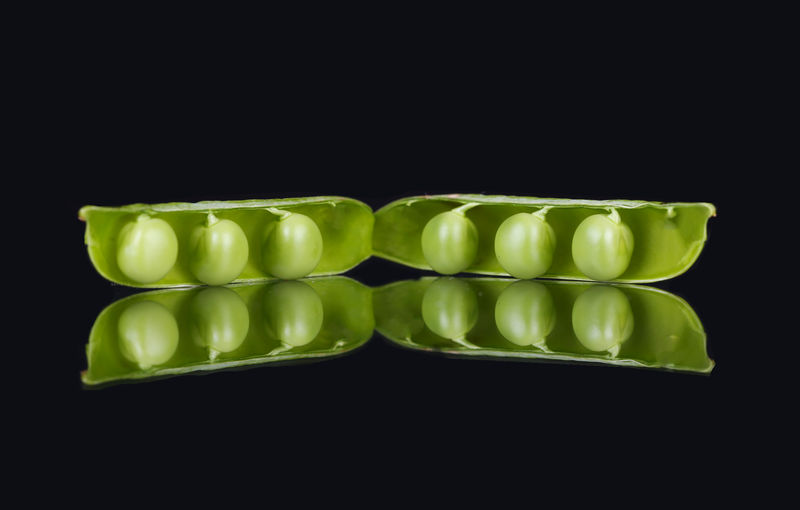 Close-up of green candies against black background