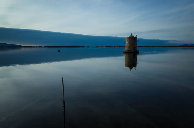 Spanish Mill reflecting in the lagoon, Orbetello, Tuscany, Italy Italia Laguna Reflection Toscana Tuscany Windmill Beauty In Nature Day Italy Lagoon Lake Mill Monte Argentario Mulino Nature No People Orbetello Outdoors Reflection Reflections Scenics Sky Tranquil Scene Tranquility Water