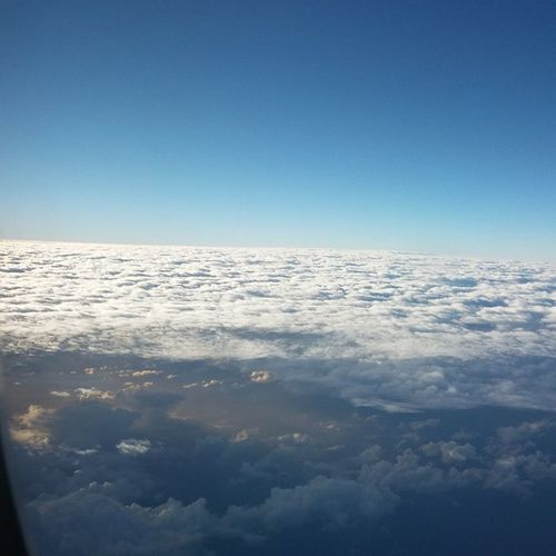 Flying high above the Clouds . InFlightPhoto Anuhea HighAboveTheClouds BlueSky Airplane View WindowSeat NoFilter OverThePacificOcean