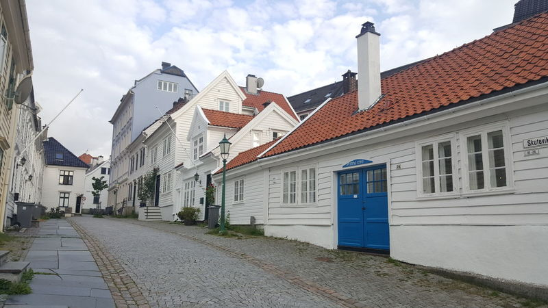 """Bergen (Norwegian pronunciation: [ˈbærɡən] ( listen), historically Bjørgvin, is a city and municipality in Hordaland on the west coast of Norway. At the end of the first quarter of 2016, the municipality's population was 278,121, and the urban population was 250,420 as of 1 January 2015, making Bergen the second-largest city in Norway. The municipality covers an area of 465 square kilometres (180 sq mi) and is located on the peninsula of Bergenshalvøyen. The city centre and northern neighbourhoods are located on Byfjorden, """"the city fjord"""", and the city is surrounded by mountains; Bergen is known as the city of seven mountains. Many of the extra-municipal suburbs are located on islands. Bergen is the administrative centre of Hordaland and consists of eight boroughs—Arna, Bergenhus, Fana, Fyllingsdalen, Laksevåg, Ytrebygda, Årstad and Åsane. Trading in Bergen may have started as early as the 1020s. According to tradition, the city was founded in 1070 by king Olav Kyrre; its name was Bjørgvin, """"the green meadow among the mountains"""". It served as Norway's capital in the 13th century, and from the end of the 13th century became a bureau city of the Hanseatic League. Until 1789, Bergen enjoyed exclusive rights to mediate trade between Northern Norway and abroad and it was the largest city in Norway until the 1830s when it was surpassed by the capital, Oslo. What remains of the quays, Bryggen, is a World Heritage Site. The city was hit by numerous fires over the years. The """"Bergen School of Meteorology"""" was developed at the Geophysical Institute beginning in 1917, the Norwegian School of Economics was founded in 1936, and the University of Bergen in 1946. From 1831 to 1972, Bergen was its own county. In 1972 the municipality absorbed four surrounding municipalities, and at the same time became a part of Hordaland county. The city is an international centre for aquaculture, shipping, offshore petroleum industry and subsea technology, and a national centre for higher educat"""