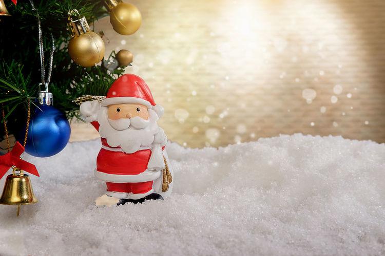 Close-up of christmas tree on snow