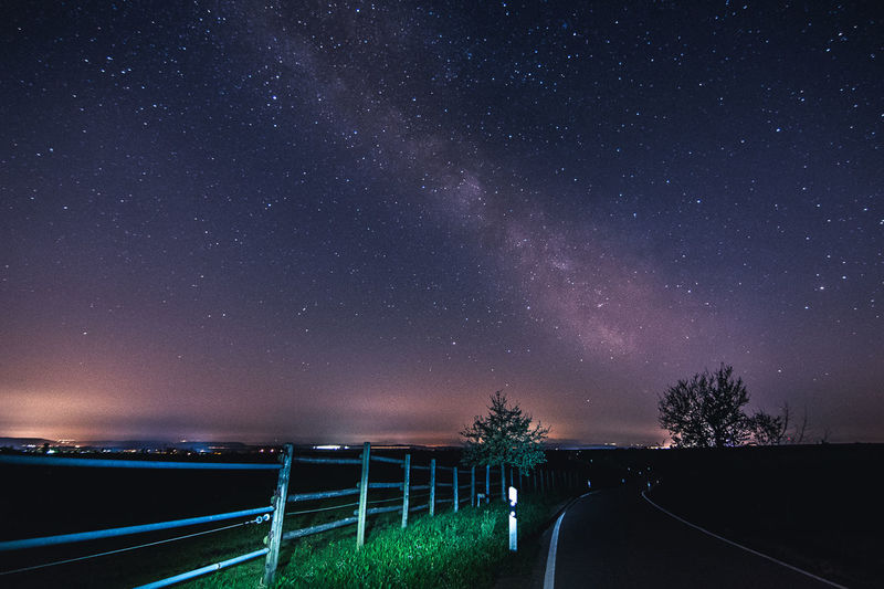 MIlky way near Stuttgart EyeEmNewHere Astronomy Beauty In Nature Direction Galaxy Nature Night No People Outdoors Plant Road Scenics - Nature Sky Space Star Star - Space Star Field The Way Forward Tranquil Scene Tranquility Transportation Tree