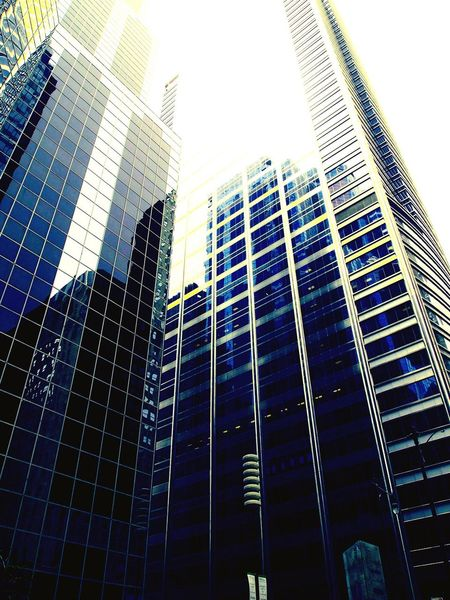 The Color Of Business Financial District  Skyscraper City Low Angle View Architecture Building Exterior Tall - High Modern Built Structure Tower Office Building Sky Tall Day Capital Cities  Building Story Urban Skyline No People