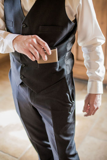 Midsection One Person Standing Men Real People Indoors  Low Section Clothing Holding Focus On Foreground Formalwear Well-dressed Lifestyles Front View Business Occupation Day Hand Adult Flask Formal Attire Wedding Day Menswear Wedding