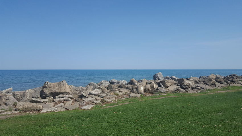 Clear Sky Lakefront Land Water And Sky Beauty In Nature Horizon Over Water Lakeshore Scenics - Nature Tranquility