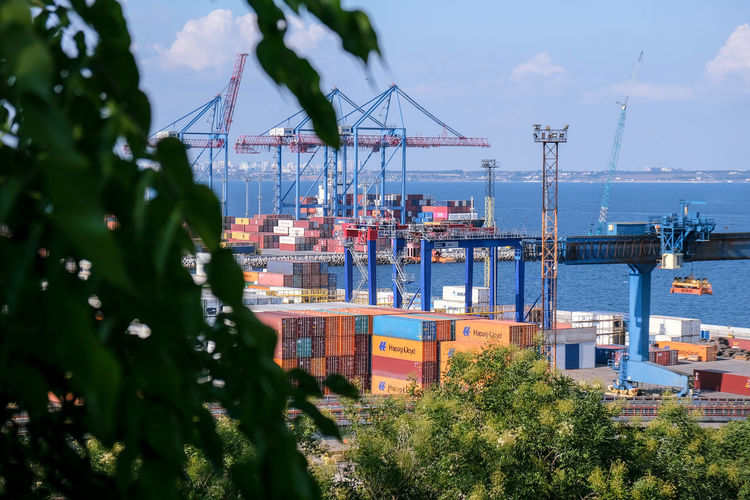 Panoramic view of commercial dock against sky