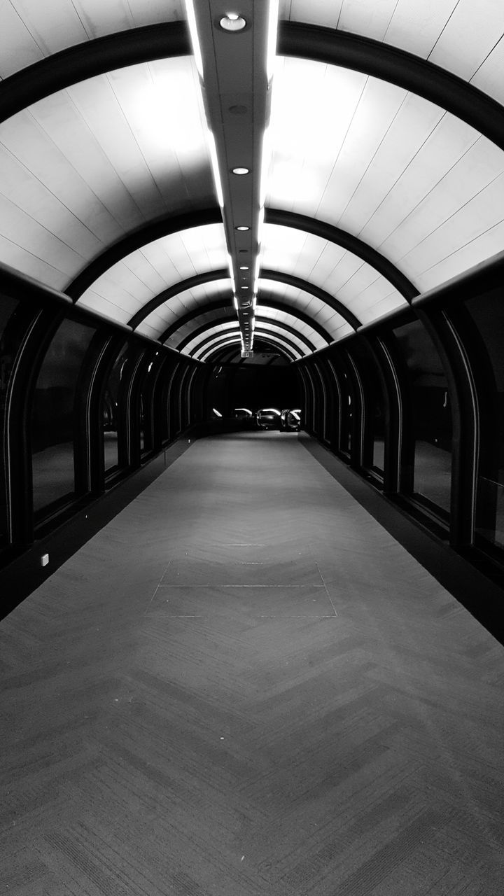 the way forward, direction, transportation, diminishing perspective, architecture, illuminated, indoors, ceiling, built structure, public transportation, lighting equipment, in a row, arch, subway, no people, empty, tunnel, subway station, footpath, long, flooring, light, underpass, underground walkway, light fixture