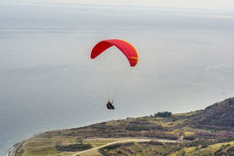 High Angle View Of Skydiver Above Beach