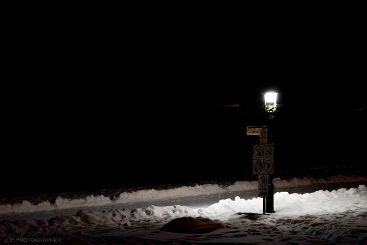 Illuminated lamp at night during winter