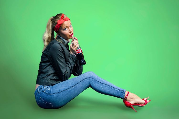 Full Length Casual Clothing Young Adult Person Lifestyles Leisure Activity Young Women Green Color Jacket Person Looking Down Relaxation Shoe Confidence  Field Long Hair Looking At Camera Cross-legged Day Well-dressed Pinup Cocacola