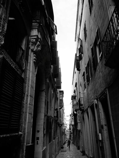 Architecture Built Structure Low Angle View Day Building Exterior Sky City Outdoors No People Narrow Street Valletta,Malta EyeEmNewHere Monochrome Photography Blackandwhite Photography Houses And Windows Valletta Architecture Travel Destinations City Valletta European Capital Of Culture 2018 Random Photography Monochrome _ Collection Black And White Friday