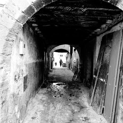 Old medina Essaouira Blackandwhite Bw BW_photography Old Buildings Photography Photooftheday Bw_collection Bwlover Men Tunnel Arch Walking Full Length Architecture Built Structure Door Archway Door Knocker