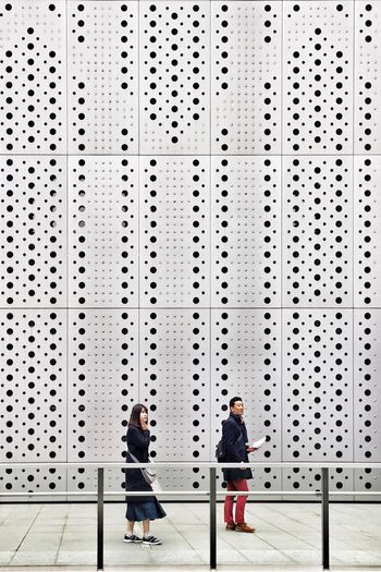 People standing on wall