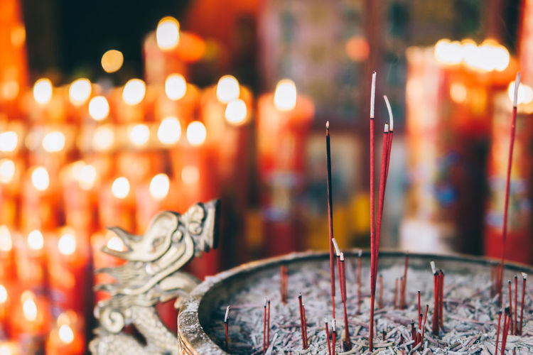 Close-Up Of Incense Sticks In Temple