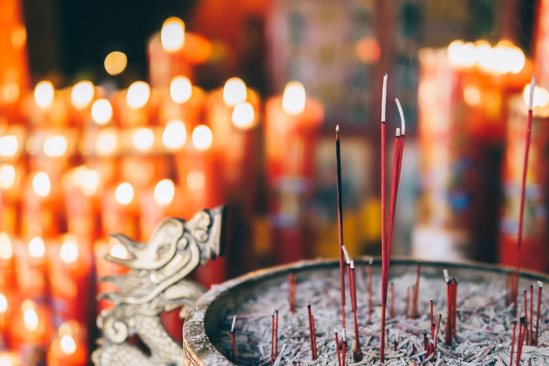 Ash Brass Burning Candle Close-up Detail Dragon Flame Focus On Foreground Hio Illuminated Incense Indoors  Light Night No People Place Of Worship Red Red Color Religion Smoke Smoke - Physical Structure Spirituality EyeEmNewHere Miles Away The Street Photographer - 2017 EyeEm Awards HUAWEI Photo Award: After Dark