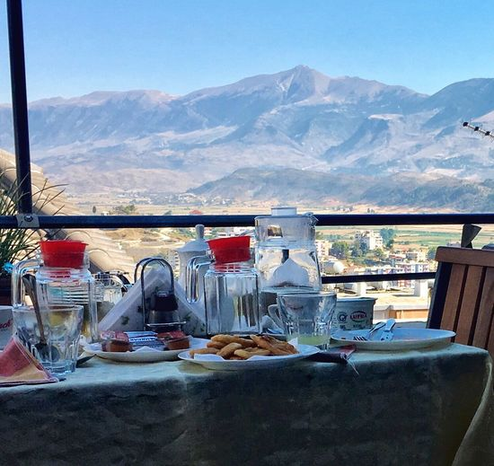 Mountain Mountain Range Table Day No People Scenics Nature Outdoors Travel Food And Drink Landscape Chair Food Clear Sky Healthy Eating Beauty In Nature Sky Albania Gjirokaster Old Bazaar Mix Yourself A Good Time