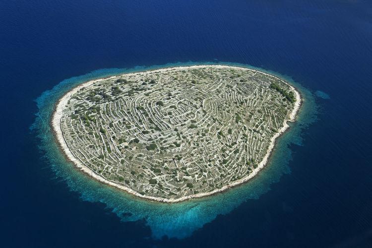 Baljenac island with ancient dry walls in adriatic, croatia