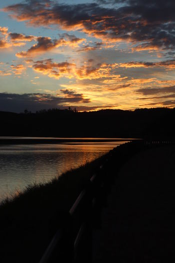 Scenic view of sunset over lake